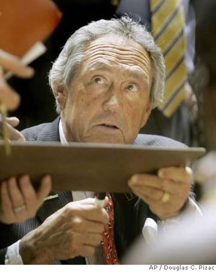 San Francisco head coach Eddie Sutton talks with his team during a huddle against Weber State during the first half of the college basketball game Friday, Dec. 28, 2007, in Ogden, Utah. (AP Photo/Douglas C. Pizac) EFE OUT Photo: Douglas C. Pizac