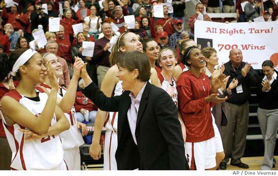 Stanford's head coach Tara Vanderveer, center, gets congratulated by her team and the fans after they beat Washington State 105-47 to give her the 700th win of her coaching career in a Pacific-10 NCAA basketball game, Friday, Dec. 28, 2007 in Stanford, Calif. (AP Photo/Dino Vournas) Photo: Dino Vournas