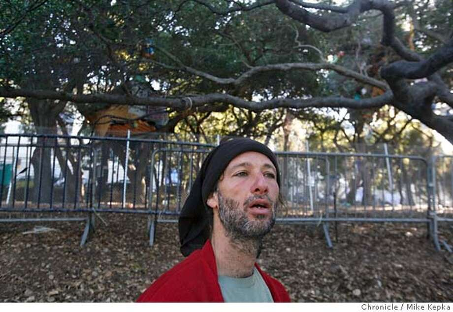 A man who calls himself Ayr, has been posted as ground support for the past 10 months for the group of protesting treesitters in the oak trees outside of memorial stadium on UC Berkeley Campus in Berkeley, Calif. He insists that he has no plans to go anywhere despite a ruling made be a judge Monday stating that one specific tresitter must leave.  Mike Kepka / The Chronicle Photo taken on 10/2/07, in San Francisco, CA, USA MANDATORY CREDIT FOR PHOTOG AND SAN FRANCISCO CHRONICLE/NO SALES-MAGS OUT Photo: Mike Kepka