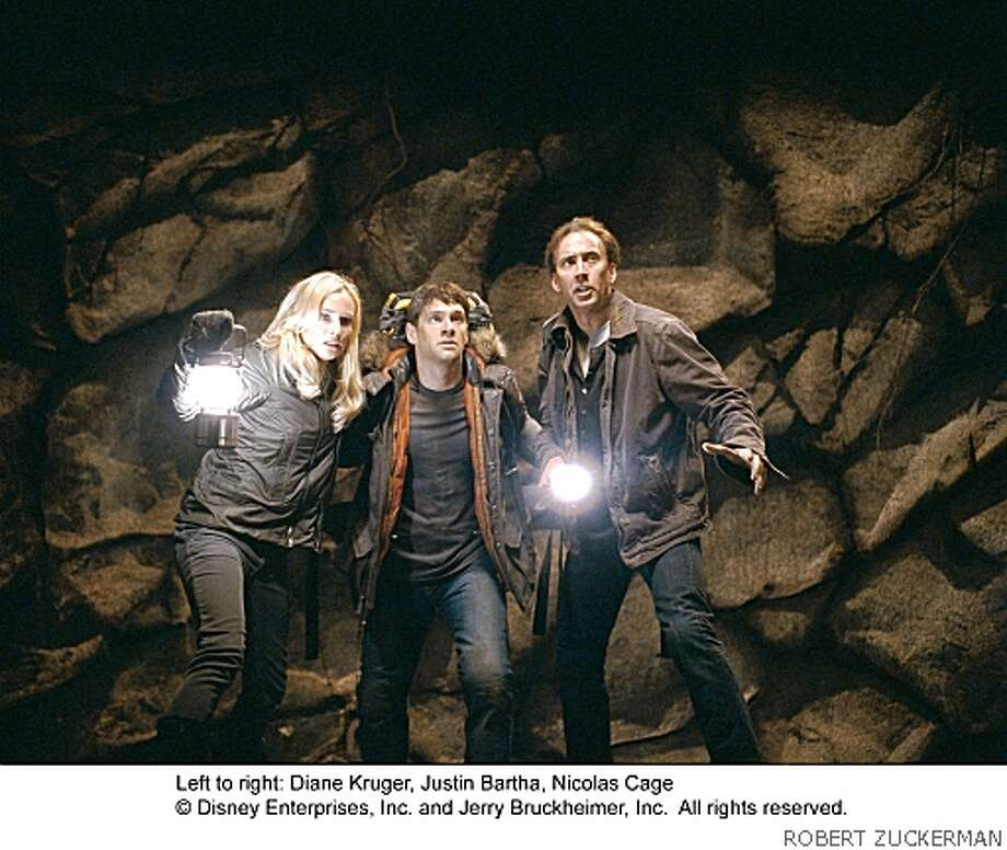 """NATIONAL TREASURE: THE BOOK OF SECRETS""PH:ROBERT ZUCKERMAN© 2007 Buena Vista Pictures and JERRY BRUCKHEIMER, Inc. All rights reserved.Ran on: 12-21-2007Diane Kruger, Justin Bartha and Nicolas Cage in &quo;National Treasure: Book of Secrets.&quo;Ran on: 12-29-2007Carol Anderson (right) of Piedmont read two reviews of &quo;Enchanted&quo; before bringing her sons Henry Bendon, 10, (left) and Isaac Bendon, 6, to see it in San Francisco on Christmas Eve. She's part of the parent-driven success of movies with G and PG ratings. Photo: ROBERT ZUCKERMAN"