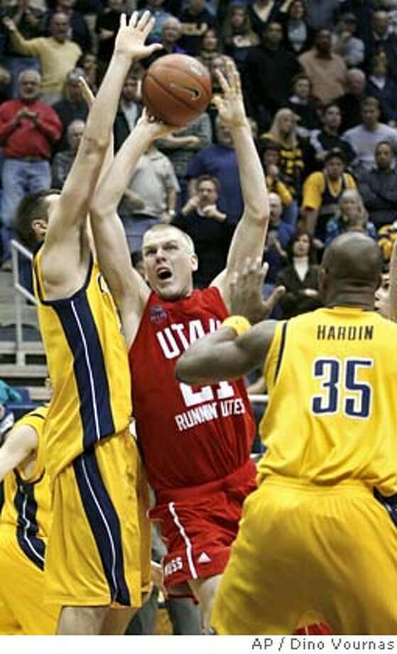 Utah's Shaun Green (21) puts up the winning basket between California's Ryan Anderson, left, and DeVon Hardin with a few seconds left in a basketball game Saturday, Dec. 22, 200, in Berkeley, Calif. Utah won 67-65. (AP Photo/Dino Vournas) Photo: Dino Vournas