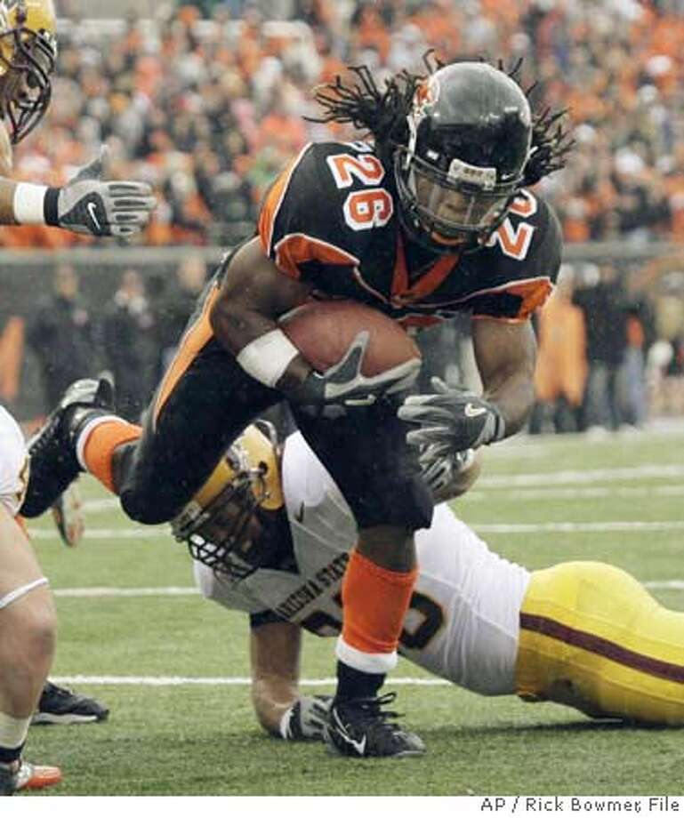Oregon State's Yvenson Bernard (26) scores as Arizona State's Mike Nixon misses a tackle during the first quarter of a football game Saturday, Nov. 4, 2006, in Corvallis, Ore. (AP Photo/Rick Bowmer)  Ran on: 11-05-2006  Oregon State's Yvenson Bernard scores the first of his two touchdowns.  Ran on: 11-05-2006  Oregon State's Yvenson Bernard scores the first of his two touchdowns.  Ran on: 11-05-2006 EFE OUT Photo: RICK BOWMER