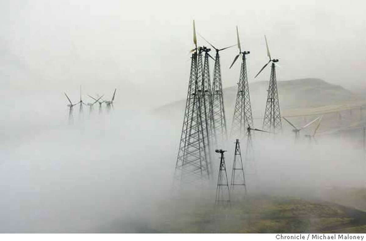 Wind turbines in the fog covered hills of the Altamont Pass. This time of the year they are shut down to reduce bird kills. Recent studies of wind farms in the Altamont Pass near Livermore estimated that electricity-producing windmills kill thousands of birds a year, including many birds of prey such as the golden eagle, red-tailed hawk, American kestral and burrowing owls.The result of these studies has been a prolonged civil war in the environmental camp, pitting defenders of wildlife against promoters of climate-friendly renewable energy, with Alameda County supervisors left to decide what to do. Photo by Michael Maloney / San Francisco Chronicle MANDATORY CREDIT FOR PHOTOG AND SF CHRONICLE/NO SALES-MAGS OUT