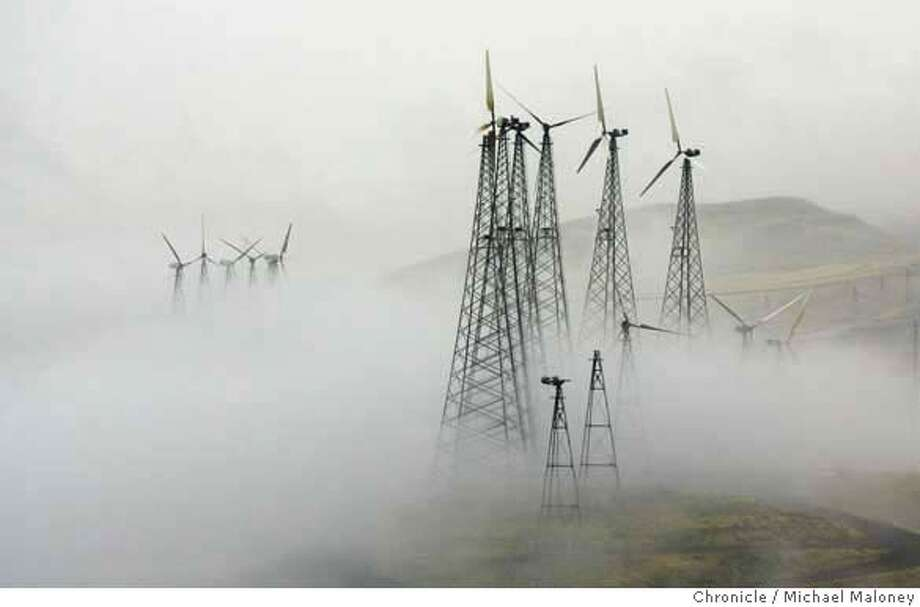 Wind turbines in the fog covered hills of the Altamont Pass. This time of the year they are shut down to reduce bird kills.  Recent studies of wind farms in the Altamont Pass near Livermore estimated that electricity-producing windmills kill thousands of birds a year, including many birds of prey such as the golden eagle, red-tailed hawk, American kestral and burrowing owls.The result of these studies has been a prolonged civil war in the environmental camp, pitting defenders of wildlife against promoters of climate-friendly renewable energy, with Alameda County supervisors left to decide what to do.  Photo by Michael Maloney / San Francisco Chronicle MANDATORY CREDIT FOR PHOTOG AND SF CHRONICLE/NO SALES-MAGS OUT Photo: Michael Maloney