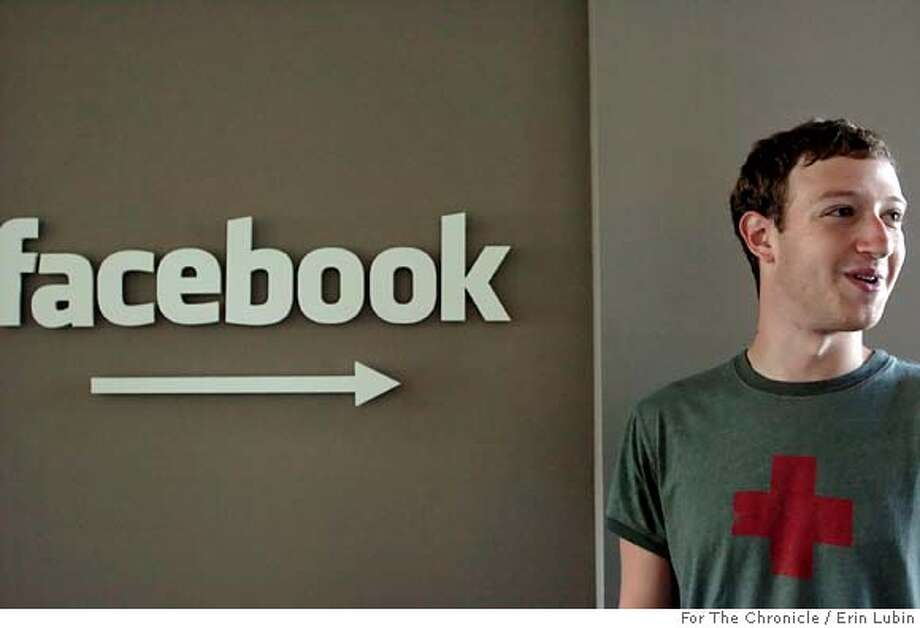 FACEBOOK_EAL_004.JPG Mark Zuckerberg, Co-founder and CEO of Facebook, stands in front of his company's sign at the Facebook office in downtown Palo Alto Thursday, August 17, 2006. Facebook is a popular website where college and high school students can put their profile online and connect to their classmates. Event on 8/17/06 in Palo Alto.  Erin Lubin / For the Chronicle  Ran on: 12-23-2007  Mark Zuckerberg, co-founder and CEO of Facebook, has had an eventful year, from a big Microsoft investment to an uproar over privacy concerns by users of the popular site.  Ran on: 12-23-2007 Ran on: 12-23-2007 Photo: Erin Lubin