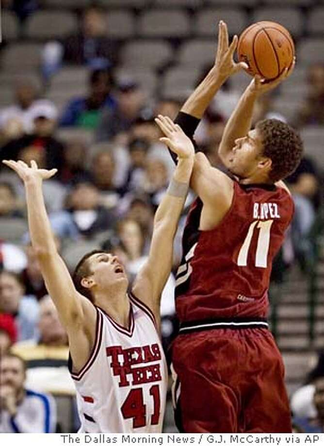 Stanford Cardinal Brook Lopez (11) gets above Texas Tech Red Raider defender Damir Suljagic to score in the second half of the O'Reilly Red Raider Christmas Classic basketball game Saturday Dec. 22, 2007, at the American Airlines Center in Dallas, Tx. Stanford won the game 62-61. (AP Photo/The Dallas Morning News, G.J. McCarthy)) **MANDATORY CREDIT, NO SALES, MAGS OUT, TV OUT, INTERNET USE BY AP MEMBERS ONLY** Photo: G.J. McCarthy