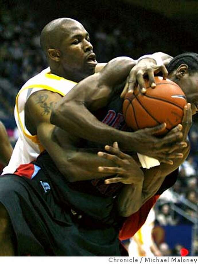 Cal Bears DeVon Hardin (35) and Delaware State Hornets Frisco Sandidge (55) battle for a rebound in the 1st half.  Cal Berkeley men's basketball team hosts Delaware State in a game at Haas Pavilion on the UCB campus Thursday night, December 20, 2007 Photo by Michael Maloney / San Francisco Chronicle MANDATORY CREDIT FOR PHOTOG AND SF CHRONICLE/NO SALES-MAGS OUT Photo: Michael Maloney