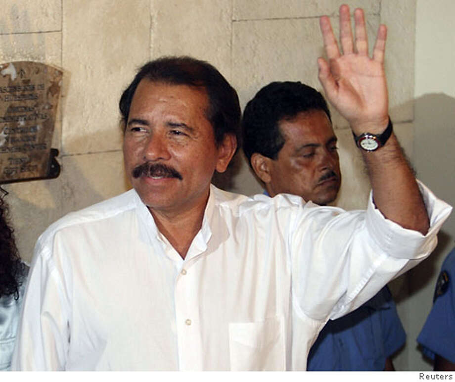 Sandinista leader and presidential candidate Daniel Ortega waves after a meeting with former U.S. President Jimmy Carter at a hotel in Managua November 6, 2006. REUTERS/Str (NICARAGUA)  Ran on: 11-08-2006  Children play near a Managua building condemned after Nicaragua's devastating 1972 quake. Photo: STR