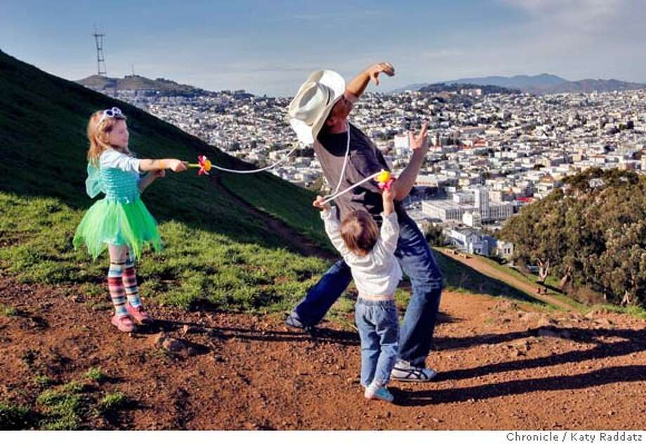 CHRISTMAS_FEATURE  Dan Duane took his daughters Hannah Duane, age 5 (L) and Audrey Duane, age 2 (R) climbing on Bernal Hill Christmas Day, and ended up getting tangled in Hannah's' jump rope when they enticed him into a game of limbo. Christmas Day in San Francisco. These pictures were made on Tuesday Dec. 25, 2007, in San Francisco, CA. KATY RADDATZ/The Chronicle Photo: KATY RADDATZ
