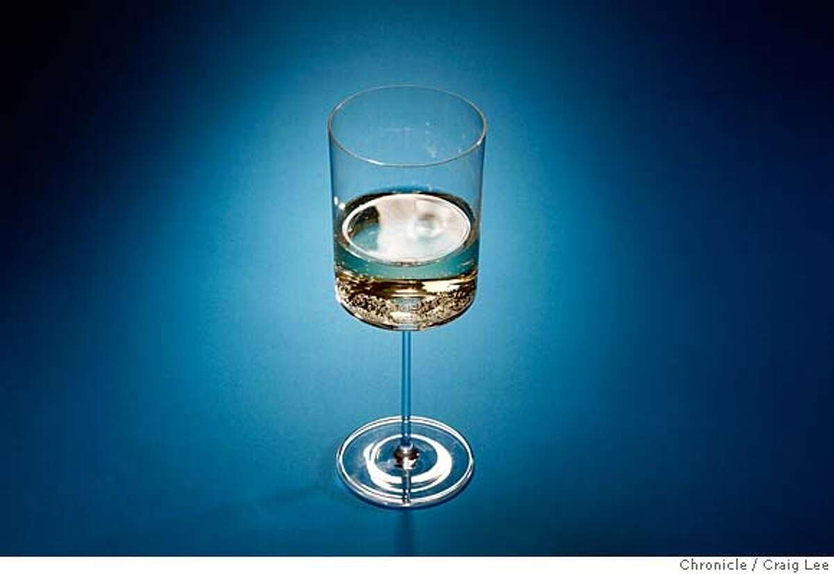 XMASPAIRINGS21_100_cl.JPG Photo of four dishes against different colored backgrounds to be paired with wine photographed against different colored backgrounds. This is a photo of white wine. on 12/11/07 in San Francisco. photo by Craig Lee / The Chronicle MANDATORY CREDIT FOR PHOTOG AND SF CHRONICLE/NO SALES-MAGS OUT