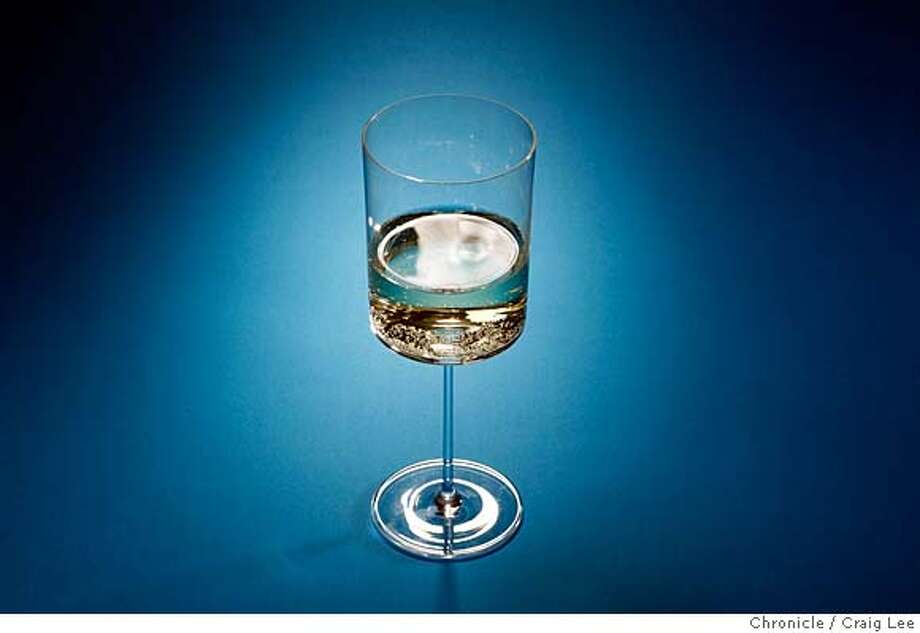 XMASPAIRINGS21_100_cl.JPG  Photo of four dishes against different colored backgrounds to be paired with wine photographed against different colored backgrounds. This is a photo of white wine.  on 12/11/07 in San Francisco. photo by Craig Lee / The Chronicle MANDATORY CREDIT FOR PHOTOG AND SF CHRONICLE/NO SALES-MAGS OUT Photo: Photo By Craig Lee