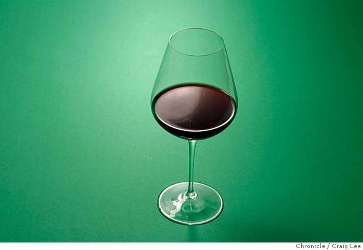 XMASPAIRINGS21_132_cl.JPG Photo of four dishes against different colored backgrounds to be paired with wine photographed against different colored backgrounds. This is a photo of a glass of red wine. on 12/11/07 in San Francisco. photo by Craig Lee / The Chronicle MANDATORY CREDIT FOR PHOTOG AND SF CHRONICLE/NO SALES-MAGS OUT