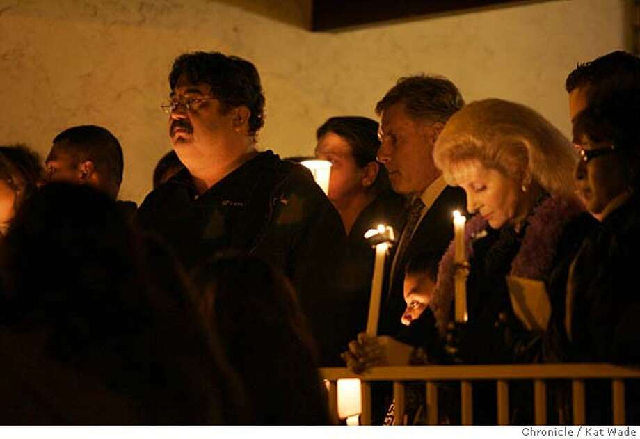 VIGIL_117_KW.JPG  Carlos' father Carlos Sousa Sr. (Glasses left) joins other family and friends as they hold a candle light vigil for Carlos Sousa, the 17-year-old killed by an escaped tiger at the San Francisco Zoo on Christmas day at his parents home on Saturday night 12/29/07 in San Jose, Ca . Photo by Kat Wade/Special to The Chronicle (CQ, Subject) Ran on: 12-30-2007  Carlos Sousa Sr. (with glasses) at the vigil for his son Carlos Sousa Jr., who was killed by the tiger. Photo: Kat Wade