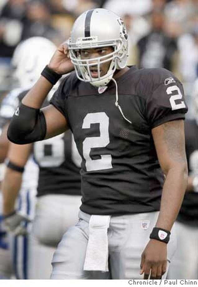 JaMarcus Russell heads for the sidelines after the Raiders were forced to punt in the third quarter of the Oakland Raiders vs. Indianapolis Colts NFL game at McAfee Coliseum in Oakland, Calif. on Sunday, Dec. 16, 2007. The Colts beat the Raiders 21-14.  PAUL CHINN/The Chronicle MANDATORY CREDIT FOR PHOTOGRAPHER AND S.F. CHRONICLE/NO SALES - MAGS OUT Photo: PAUL CHINN