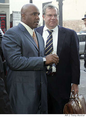 Former San Francisco Giants Barry Bonds and his attorney Alan Ruby, right, arrives at the Philip Burton Federal Building in San Francisco, on Friday, Dec. 21, 2007 to respond to government concerns that his legal team may have conflicts of interest because they have represented other figures in the Balco steroids scandal. (AP Photo/Tony Avelar) Photo: Tony Avelar