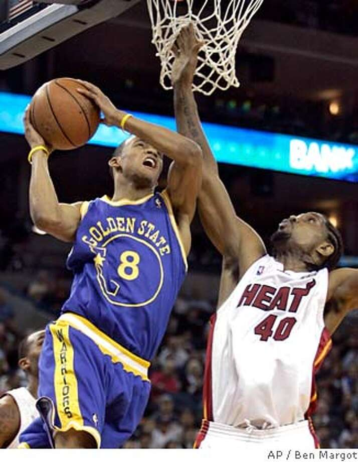 Golden State Warriors' Monta Ellis (8) goes up for a shot against Miami Heat's Udonis Haslem during the second half of an NBA basketball game Friday, Dec. 7, 2007, in Oakland, Calif. The Warriors won, 120-113. (AP Photo/Ben Margot) EFE OUT Photo: Ben Margot