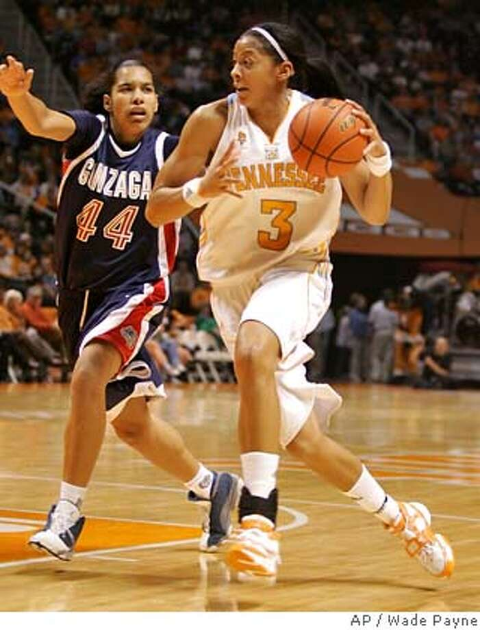 Tennessee's Candace Parker (3) drives against Gonzaga's Vivian Frieson (44) during the first half a college basketball game Sunday, Dec. 16, 2007, in Knoxville, Tenn. Parker scored 18 points in the 96-73 win.(AP Photo/Wade Payne) EFE OUT Photo: Wade Payne