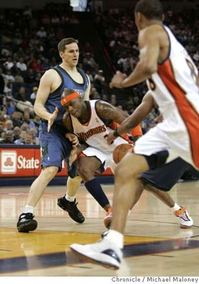 Warriors Al Harrington (3) drives to the basket in the 1st half past former Stanford star Timberwolves Mark Madsen. At right is Warriors Monta Ellis (8).  The Golden State Warriors host the Minnesota Timberwolves at Oracle Arena in Oakland, CA on Sunday, April 15, 2007.  Photo by Michael Maloney / San Francisco Chronicle ***(Roster) Al Harrington, Mark Madsen, Monta Ellis MANDATORY CREDIT FOR PHOTOG AND SF CHRONICLE/NO SALES-MAGS OUT Photo: Michael Maloney