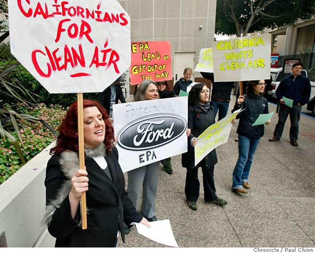 Shannon Biggs (left) and other environmentalists protest in front of the Environmental Protection Agency's offices in San Francisco, Calif. on Thursday, Dec. 20, 2007 after the agency refused to grant the state of California permission to impose stricter emissions standards. PAUL CHINN/The Chronicle **Shannon Biggs MANDATORY CREDIT FOR PHOTOGRAPHER AND S.F. CHRONICLE/NO SALES - MAGS OUT