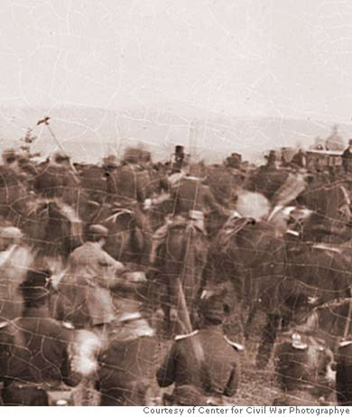 An enlargement of an Alexander Gardner photograph of the cemetery dedication at Gettysburg, Pa., is believed to include President Abraham Lincoln (center, with stovepipe hat) on horseback as he makes his way through the crowd to deliver his famed address. The finding is extraordinary as there are only about 125 known photographs of Lincoln. Illustrates CIVILWAR-LINCOLN (category a), by Linda Wheeler, special to The Washington Post. Moved Thursday, Dec. 13, 2007. (MUST CREDIT: Courtesy of Center for Civil War Photography.) LARGER SIZE PHOTO NOT AVAILABLE