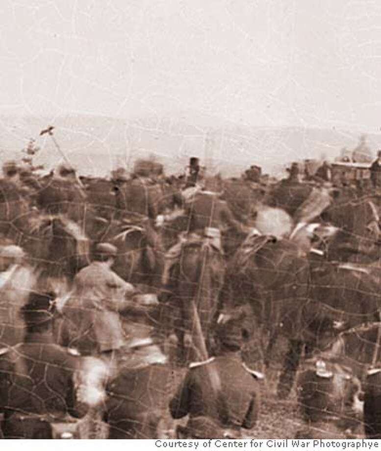 An enlargement of an Alexander Gardner photograph of the cemetery dedication at Gettysburg, Pa., is believed to include President Abraham Lincoln (center, with stovepipe hat) on horseback as he makes his way through the crowd to deliver his famed address. The finding is extraordinary as there are only about 125 known photographs of Lincoln. Illustrates CIVILWAR-LINCOLN (category a), by Linda Wheeler, special to The Washington Post. Moved Thursday, Dec. 13, 2007. (MUST CREDIT: Courtesy of Center for Civil War Photography.) LARGER SIZE PHOTO NOT AVAILABLE Photo: HANDOUT