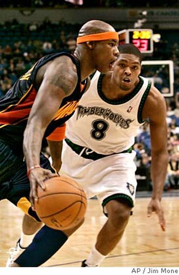 Golden State Warriors' Al Harrington, left, drives past Minnesota Timberwolves defender Ryan Gomes in third quarter of an NBA basketball game Wednesday, Dec. 19, 2007, in Minneapolis. Harrington led the Warriors with 25 points in their 111-98 victory over the Timberwolves. (AP Photo/Jim Mone) Photo: Jim Mone
