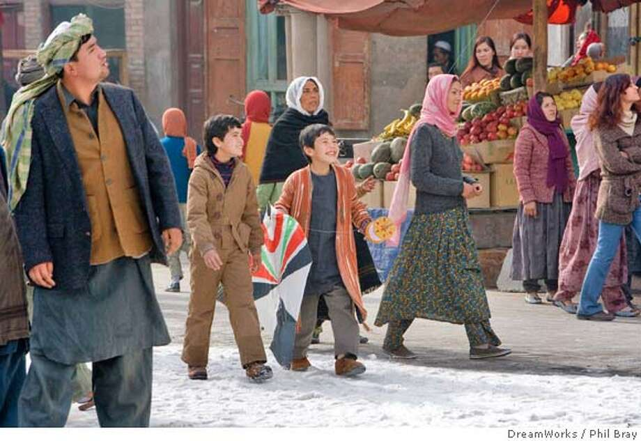 "This undated handout photo provided by Paramount shows Zekiria Ebrahimi, center left, and Ahmad Khan Mahmoodzada, center right, in a scene from ""The Kite Runner."" (AP Photo/Paramount, Phil Bray) Photo: Phil Bray"