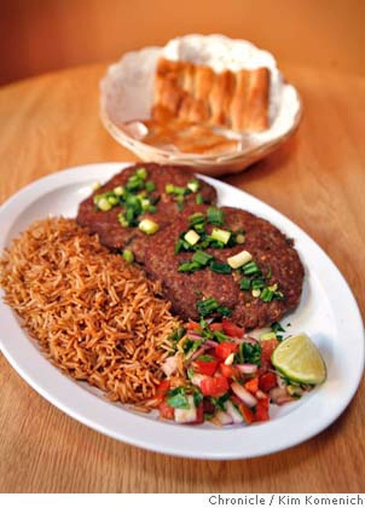 BARGAIN13_DEAFGHANAN_012_KK.JPG De Afghanan Kebob House on Polk in San Francisco is an offshoot of a couple of the popular Afghan restaurants in Fremont. Dishes include Chapli Kabob -- two beef patties with green onions. Photo by Kim Komenich/The Chronicle **