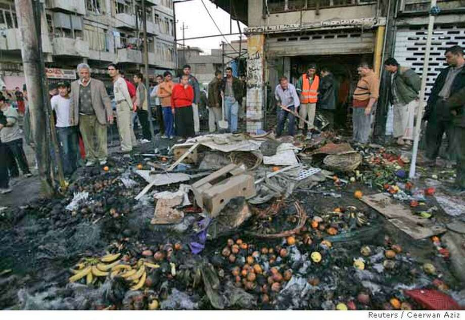 Residents gather at the site of a bomb attack in Baghdad's al-Ghadeer district December 12, 2007. Five civilians were killed while 13 others were wounded in the car bomb attack southeast of Baghdad on Wednesday, police said. REUTERS/Ceerwan Aziz (IRAQ) 0 Photo: CEERWAN AZIZ