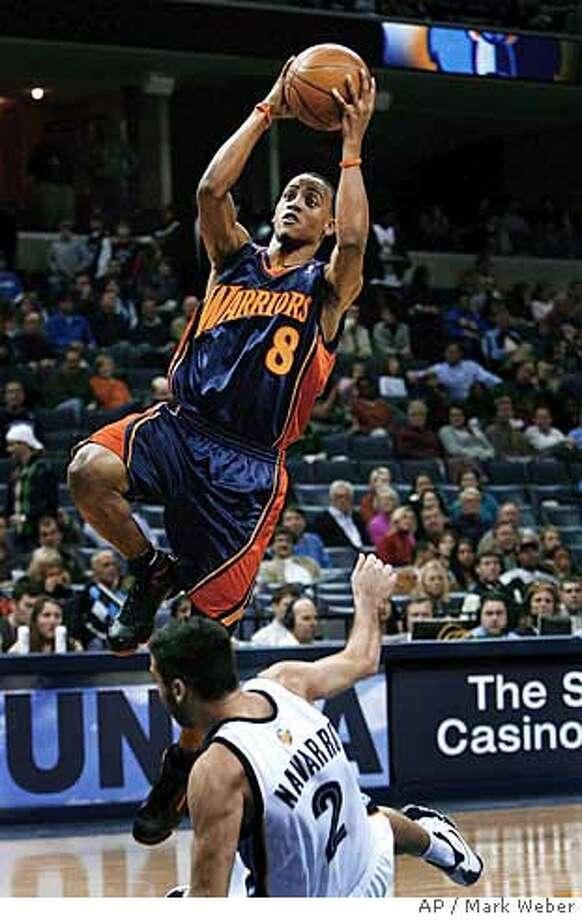 Golden State Warriors' Monta Ellis (8) takes a shot over Memphis Grizzlies' Juan Carlos Navarro (2) of Spain, in the first half of an NBA basketball game Monday, Dec. 17, 2007, in Memphis, Tenn. (AP Photo/Mark Weber) Photo: Mark Weber