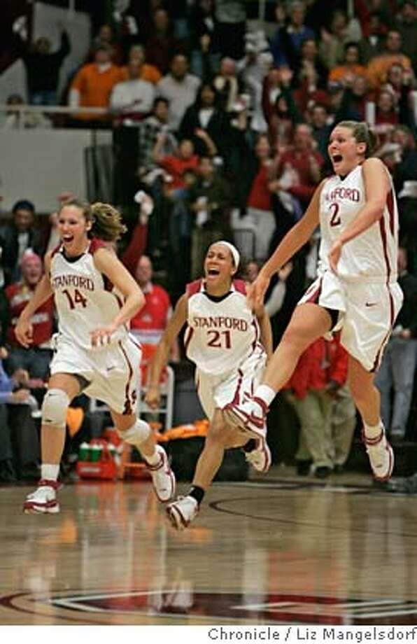 stanford_women011_lm.jpg  Stanford's # 14 Kayla Pederson, #21 Rosalyn gold-Onwude and #2 Jayne Appel celebrate after the team beat Tennessee 73-69 in OT. Stanford University plays the University of Tennessee in women's basketball. Photo by Liz Mangelsdorf, Special to the Chronicle Event on 12/22/07 in Palo Alto. MANDATORY CREDIT FOR PHOTOG AND SF CHRONICLE/NO SALES-MAGS OUT Photo: Liz Mangelsdorf