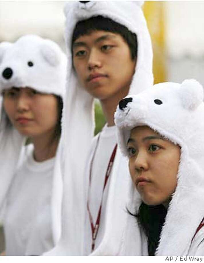 "South Korean environmental activists wear polar bear costumes during the U.N. Climate Conference Tuesday, Dec. 11, 2007 in Nusa Dua, Bali, Indonesia. Opposition from the United States and at least two major allies is likely to scuttle attempts to include emission reduction targets in a ""road map"" for future global warming talks, analysts said. (AP Photo/Ed Wray) Photo: Ed Wray"