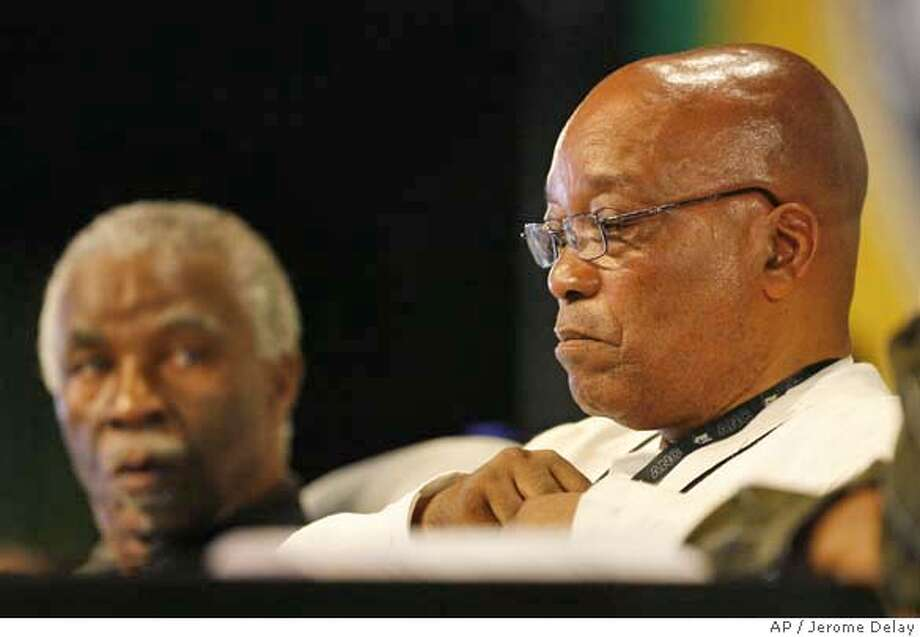 South African President Thabo Mbeki, left, looks at ANC deputy President Jacob Zuma at the opening of the 52nd African National Congress conference in Polokwane, South Africa, Sunday, Dec. 16, 2007. (AP Photo/Jerome Delay) Photo: Jerome Delay