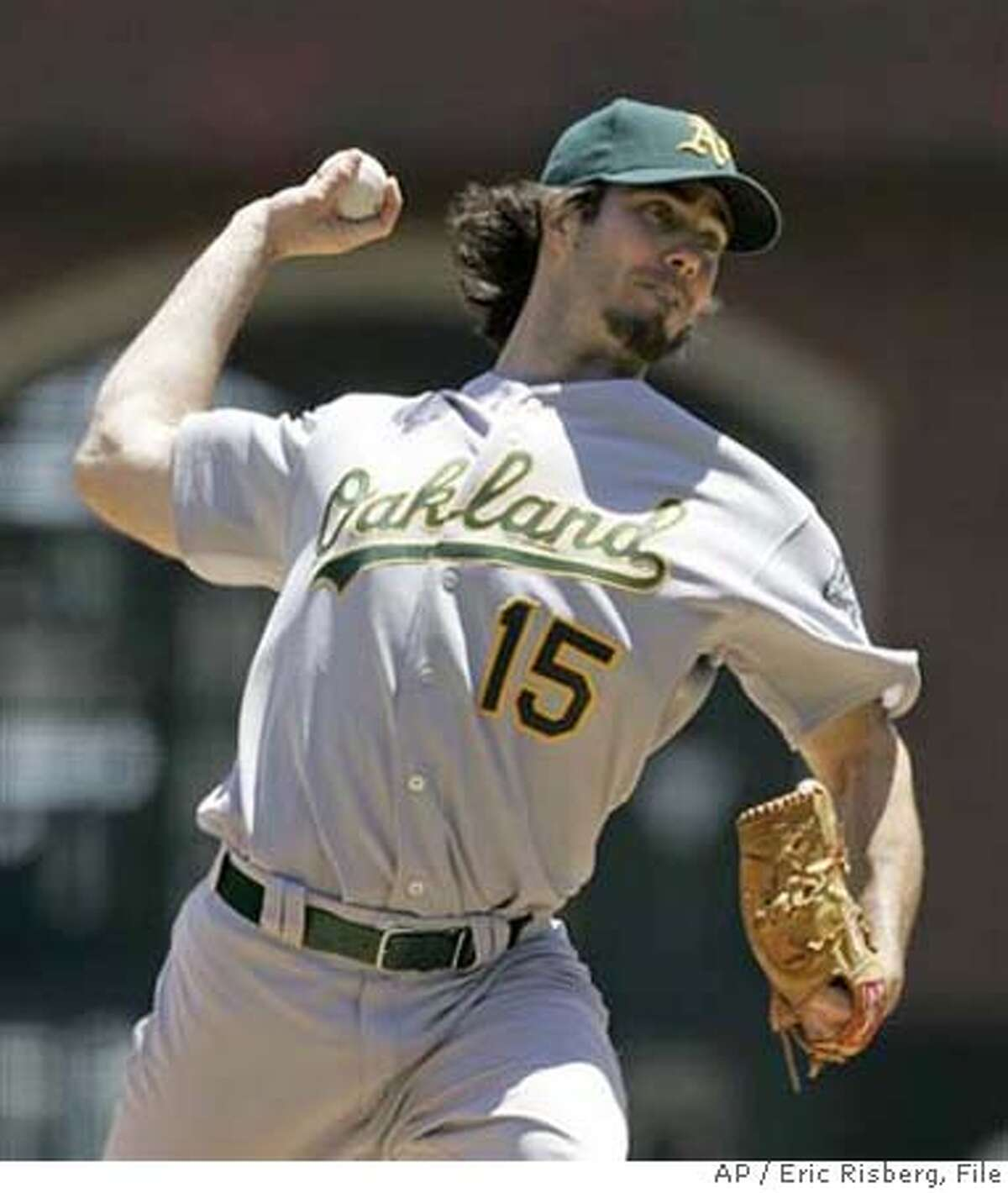** FILE ** Oakland Athletics' Dan Haren throws a pitch during a game against the San Francisco Giants in this file photo from June 9, 2007, in San Francisco. Haren and Connor Robertson, both right-handed pitchers, were traded from the Oakland Athletics to the Arizona Diamondbacks for left-handed pitchers Brett Anderson, Dana Eveland and Greg Smith; infielder Chris Carter and outfielders Aaron Cunningham and Carlos Gonzalez. (AP Photo/Eric Risberg, File)