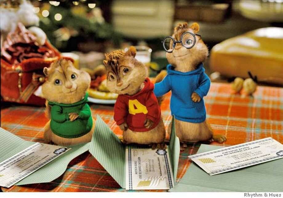 Theodore, Alvin and Simon are disappointed with the Christmas gifts presented by Dave Seville. Photo: Photo Credit: Rhythm & Hues