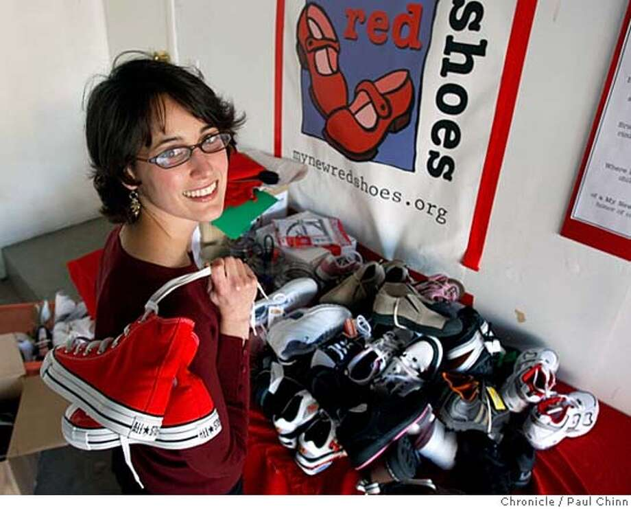 My New Red Shoes founder Heather Hopkins organizes piles of donated shoes at her home office in Menlo Park, Calif. on Wednesday, Dec. 5, 2007. Hopkins is a Jefferson Award winner for starting the non-profit which provides new clothes and shoes for homeless and underprivileged children up and down the Peninsula to wear on the first day of school. PAUL CHINN/The Chronicle  **Heather Hopkins MANDATORY CREDIT FOR PHOTOGRAPHER AND S.F. CHRONICLE/NO SALES - MAGS OUT Photo: PAUL CHINN
