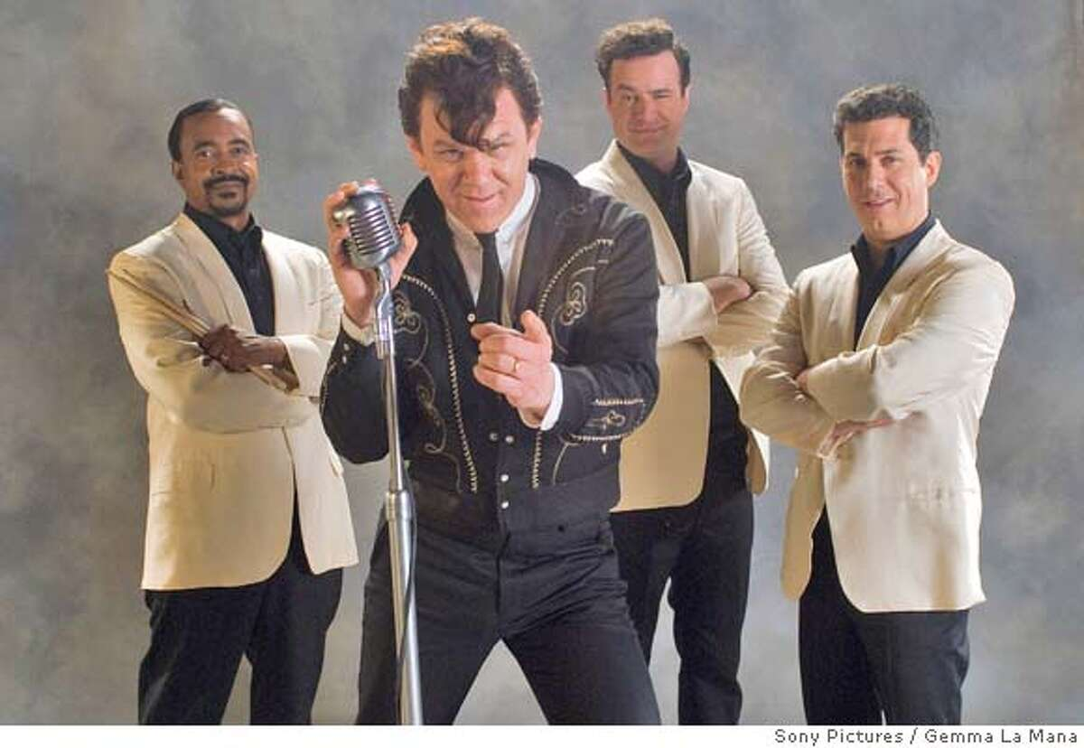"""This undated photo provided by Sony Pictures shows, from left to right, Tim Meadows, John C. Reilly, Matt Besser and Chris Parnell from the movie """"Walk Hard: The Dewey Cox Story."""" (AP Photo/Sony Pictures, Gemma La Mana)"""