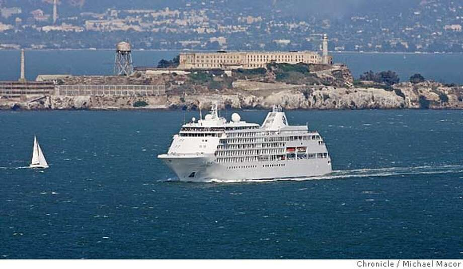"tourism13_130_mac.jpg The Silversea Cruise Line, ""Silver Shadow"" crosses San francisco Bay. San francisco has seen an increase of cruise ship traffic into the Bay. Business section feature about why San Francisco seems to be experiencing a very busy summer tourist season. All the numbers are up from alst year and the last several years. We talk to hoteliers, conventions planners and tourists themselves to find out why. Event in, San Francisco, Ca, on 8/9/06. Photo by: Michael Macor / San Francisco Chronicle  Ran on: 08-20-2006  Pedestrians board a cable car at California and Powell streets. San Francisco hasn't attracted as many tourists as it has this summer since the dot-com boom before Sept. 11, 2001. Mandatory credit for Photographer and San Francisco Chronicle No sales/ Magazines Out Photo: Michael Macor"