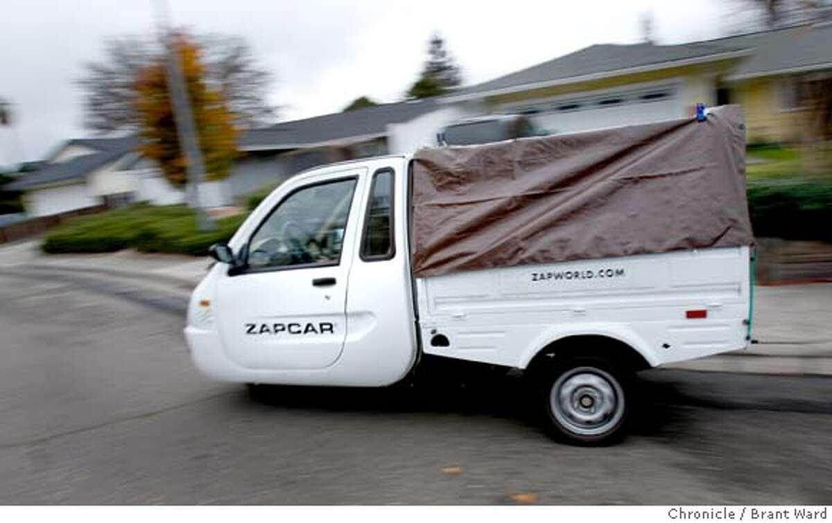 electriccar_146.JPG A ZAP electric car leased by UPS is driven by Sherri Almond as she makes her deliveries in Rohnert Park. All electric three-wheel vehicles made by ZAP of Santa Rosa are being leased by United Parcel Service for their deliveries in residential areas where parking and traffic could be a problem for bigger trucks. These scenes from Rohnert Park, Sonoma County. {By Brant Ward/San Francisco Chronicle}12/17/07