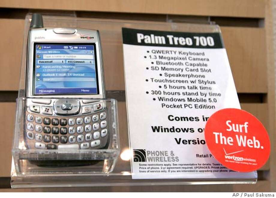 A Palm Treo 700 phone on display at a Verizon store in Salinas, Calif., Monday, June 4, 2007. Smartphone maker Palm Inc. will sell a 25 percent stake to private equity firm Elevation Partners for $325 million and name the former technical guru behind the iPod to be chairman, the company said Monday. The deal with the long-term investor brings significant new leadership to Palm, which has been battling stiffening competition in a market that is only going to get tougher with Apple Inc.'s June 29 debut of the iPhone. (AP Photo/Paul Sakuma)  Ran on: 06-05-2007  This Palm Treo 700 is on display at a Verizon store in Salinas. Smart-phone maker Palm Inc. will sell a 25 percent stake to private equity firm Elevation Partners for $325 million.  Ran on: 12-14-2007  Treo-maker Palm will &quo;align resources&quo; through staff cuts. Photo: Paul Sakuma