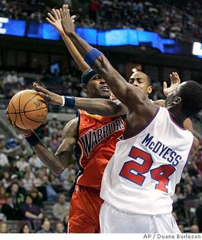 Golden State Warriors forward Stephen Jackson, left, looks to pass against Detroit Pistons forward Antonio McDyess (24) and Arron Afflalo, rear, in the first half of an NBA basketball game Sunday, Dec. 16, 2007, in Auburn Hills, Mich. (AP Photo/Duane Burleson) Photo: Duane Burleson
