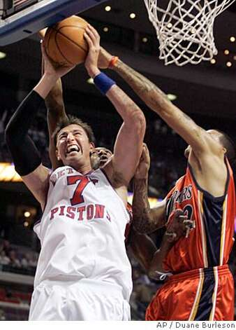 Detroit Pistons center Primoz Brezec (7), of Slovenia, goes to the basket against Golden State Warriors forward Matt Barnes, right, in the fourth quarter of an NBA basketball game Sunday, Dec. 16, 2007, in Auburn Hills, Mich. Brezac was acquired from the Charlotte Bobcats Friday. (AP Photo/Duane Burleson) Photo: Duane Burleson