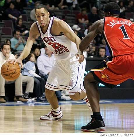 Detroit Pistons forward Tayshaun Prince, left, drives against Golden State Warriors forward Stephen Jackson (1) in the second half of an NBA basketball game Sunday, Dec. 16, 2007, in Auburn Hills, Mich. Prince led all players with 23 points in a 109-87 win. (AP Photo/Duane Burleson) Photo: Duane Burleson