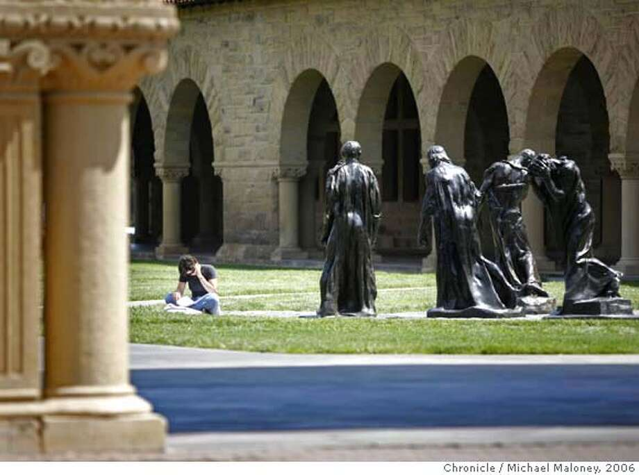 """CAMPUSNOTES_MJM_026.jpg  Stanford University senior, 21 year old Annie Wilkinson takes advantage of the warm weather to study outdoors in Memorial Court on the Stanford campus. Wilkinson, a human biology major from Missoula Montana was sitting next to the Auguste Rodin bronze sculptures titled """"The Burghers of Calais"""".  For Campus Notes, Stanford University.  Photo by Michael Maloney / San Francisco Chronicle on 5/10/06 in Stanford,CA MANDATORY CREDIT FOR PHOTOG AND SF CHRONICLE/NO SALES-MAGS OUT Photo: Michael Maloney"""