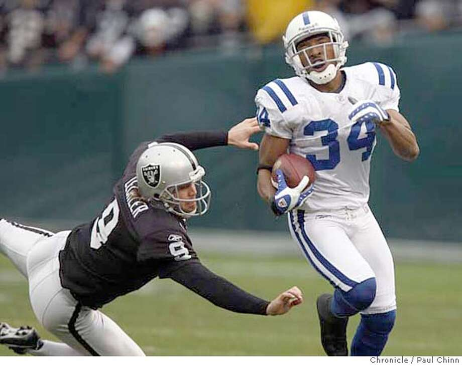 Raiders punter Shane Lechler dives unsuccessfully to stop T.J. Rushing from returning a punt for a touchdown in the first quarter of the Oakland Raiders vs. Indianapolis Colts NFL game at McAfee Coliseum in Oakland, Calif. on Sunday, Dec. 16, 2007.  PAUL CHINN/The Chronicle Photo: PAUL CHINN