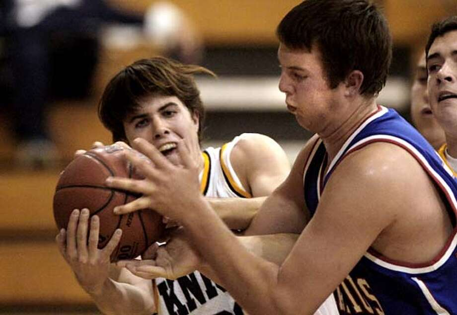 menlo_094.JPG  Menlos Max Frye, left, battled for a rebound with Vince Legarza, in blue during first half action.  Game action in high school basketball game between Menlo School and St. Ignatius played at Menlo College Tuesday night.{By Brant Ward/San Francisco Chronicle}12/11/07  Ran on: 12-12-2007  Max Frye (left) of Menlo School battles for the rebound with St. Ignatius' Vince Legarza.  Ran on: 12-12-2007  Max Frye (left) of Menlo School goes for the rebound with St. Ignatius' Vince Legarza. Photo: Brant Ward