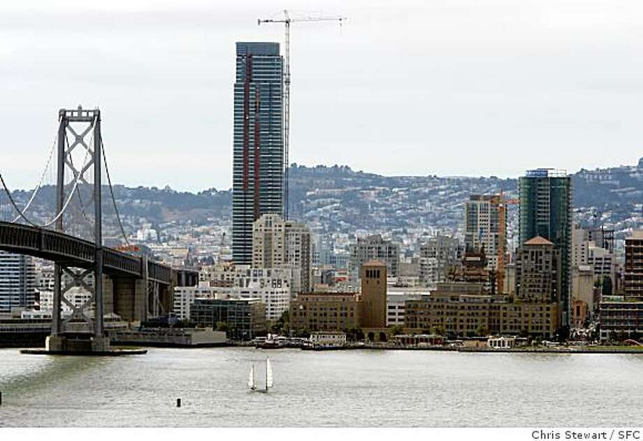 A number of new glass towers are being built in San Francisco including the Infinity (at right) - one of two luxury condominium towers of curved glass now under construction at Spear and Folsom streets. It is dwarfed by the taller One Rincon Hill at 425 First Street at Harrison Street. Photographed October 9, 2007 Photo: Chris Stewart, SFC