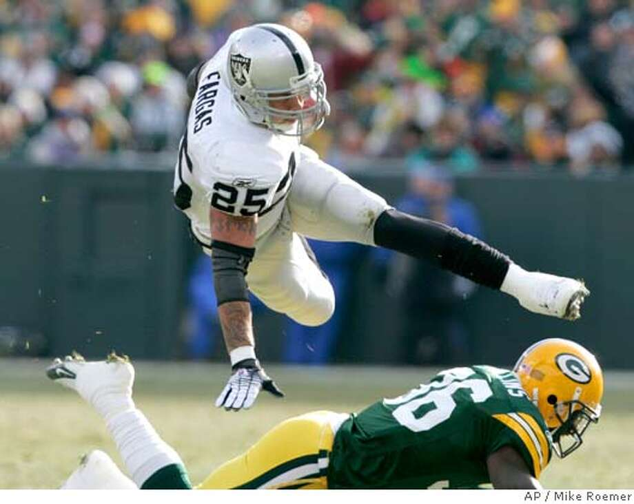 Oakland Raiders running back Justin Fargas (25) is tripped up by Green Bay Packers safety Nick Collins (36) for a two-yard loss on a fourth down run during the first half of an NFL football game Sunday, Dec. 9, 2007, in Green Bay, Wis. (AP Photo/Mike Roemer) Photo: Mike Roemer