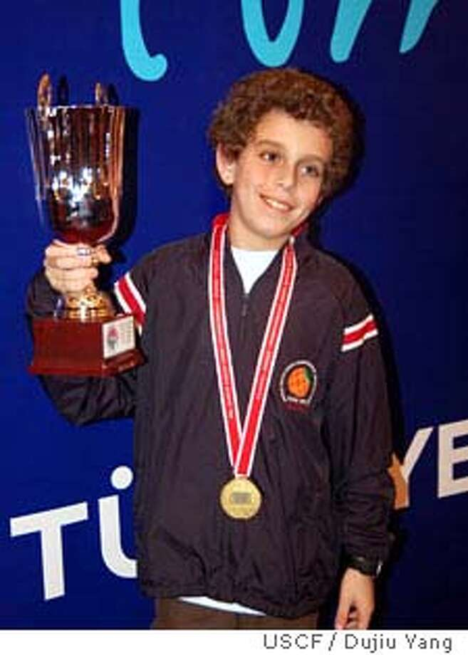 chess29_ph.jpg Daniel Naroditsky, a 6th grader from Foster City, just won the World Youth Chess Championship in Turkey. Dujiu Yang / United States Chess Federation/ Courtesy to The Chronicle  Ran on: 11-29-2007  Daniel Naroditsky holds up his trophy in Antalya, Turkey.  Ran on: 11-29-2007  Daniel Naroditsky  Ran on: 11-29-2007 Ran on: 12-05-2007  Daniel Naroditsky entered the tournament as the 13th-ranked player internationally in his group.  Ran on: 12-05-2007 Ran on: 12-05-2007 Ran on: 12-05-2007 Ran on: 12-05-2007  Daniel Naroditsky entered the tournament as the 13th-ranked player internationally in his group.  Ran on: 12-05-2007  Daniel Naroditsky entered the tournament as the 13th-ranked player internationally in his group.  Ran on: 12-05-2007  Daniel Naroditsky entered the tournament as the 13th-ranked player internationally in his group.  Ran on: 12-05-2007  Daniel Naroditsky entered the tournament as the 13th-ranked player internationally in his group. Photo: Dujiu Yang / United States Chess