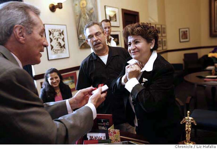 SALVADOR05_120_LH.JPG San Salvador's mayor Violeta Menjivar gives San Francisco supervisor Tom Ammiano a gift during a visit to City Hall accompanied by Ana Perez (in pink, seated) from the Central American Resource Center. Next to her is Jose Artiga, executive director of SHARE foundation who is translating for Menjivar.  Liz Hafalia/The Chronicle/San Francisco/12/5/07  **Violeta Menjivar, Tom Ammiano, Ana Perez, Jose Artiga cq �2007, San Francisco Chronicle/ Liz Hafalia  MANDATORY CREDIT FOR PHOTOG AND SAN FRANCISCO CHRONICLE. NO SALES- MAGS OUT. Photo: Liz Hafalia